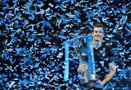 FILE PHOTO: Great Britain's Andy Murray celebrates with the ATP World Tour Finals trophy at O2 Arena, London - 20/11/16. Reuters / Toby Melville