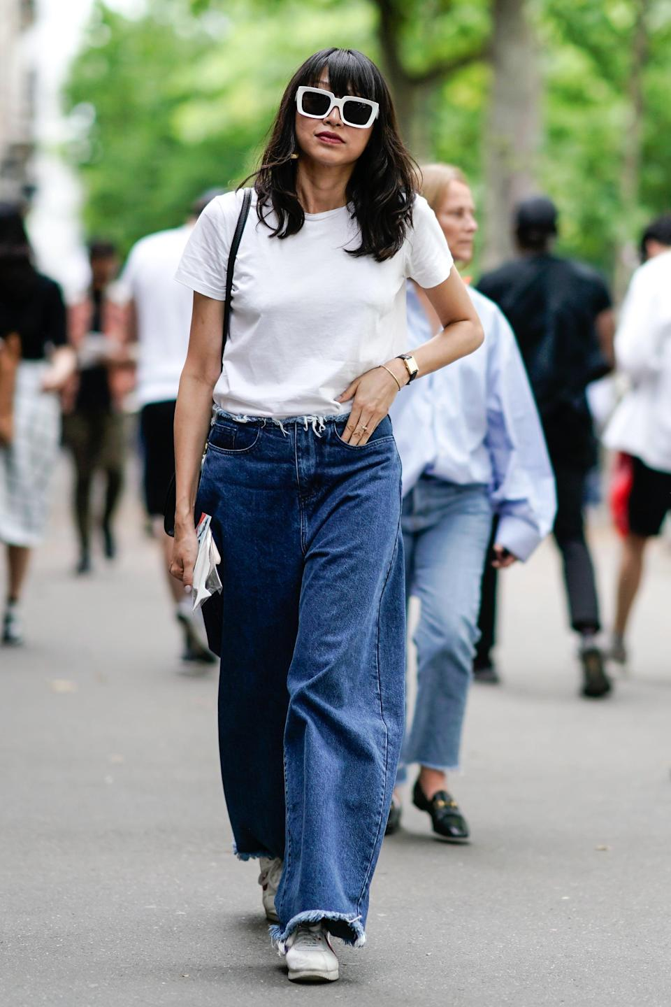 <p>Channel a street-style vibe with loose-fitting denim that's frayed at the waist and hem. Bonus points for adding a throwback sneaker into the mix.</p>