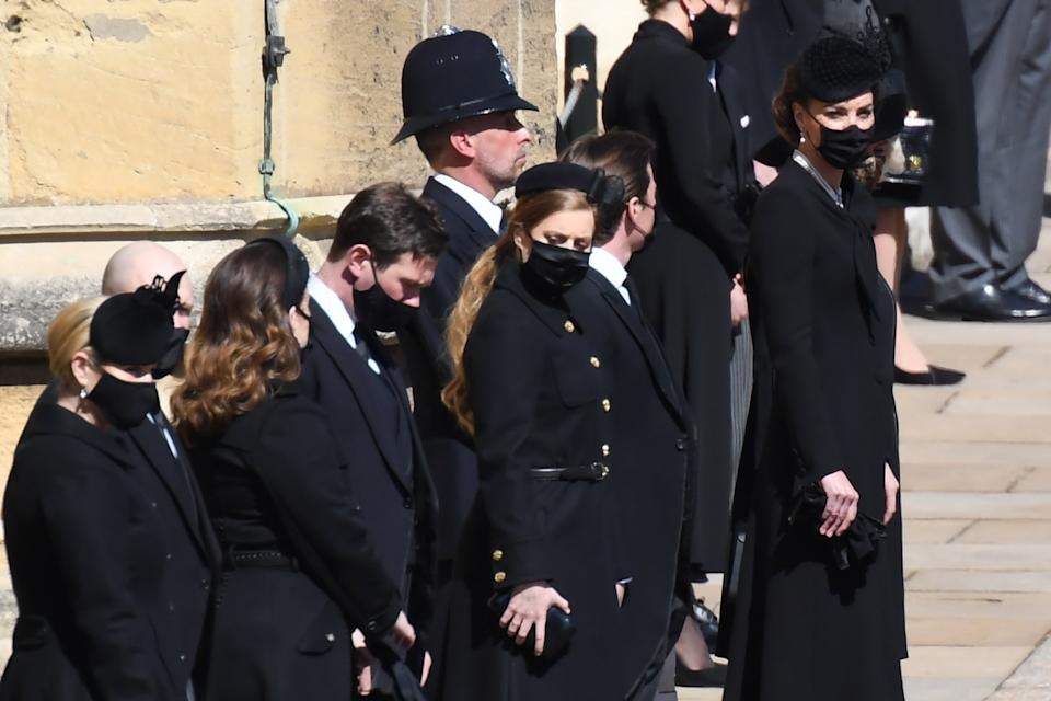 WINDSOR, ENGLAND - APRIL 17: Zara Tindall, Mike Tindall, Princess Eugenie, Jack Brooksbank, Princess Beatrice,  Edoardo Mapelli Mozzi, Catherine, Duchess of Cambridge and Camilla, Duchess of Cornwall stand outside St George's Chapel for the funeral service of Britain's Prince Philip, Duke of Edinburgh in Windsor Castle on April 17, 2021 in Windsor, United Kingdom. Prince Philip of Greece and Denmark was born 10 June 1921, in Greece. He served in the British Royal Navy and fought in WWII. He married the then Princess Elizabeth on 20 November 1947 and was created Duke of Edinburgh, Earl of Merioneth, and Baron Greenwich by King VI. He served as Prince Consort to Queen Elizabeth II until his death on April 9 2021, months short of his 100th birthday. His funeral takes place today at Windsor Castle with only 30 guests invited due to Coronavirus pandemic restrictions. (Photo by Jeremy Selwyn-WPA Pool/Getty Images)