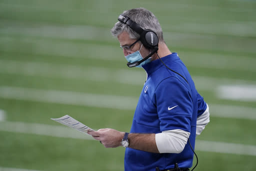 Indianapolis Colts head coach Frank Reich looks at his play chart during the second half of an NFL football game against the Jacksonville Jaguars, Sunday, Jan. 3, 2021, in Indianapolis. (AP Photo/Michael Conroy)