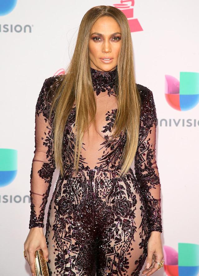 <p>The fashion chameleon that is J.Lo rocked sleek, long locks à la Cher that fell to her waist at the 2016 Latin Grammy Awards. Conveniently, she could use her hair to cover anything that wasn't covered by her racy ensemble! (Photo: JB Lacroix/WireImage) </p>