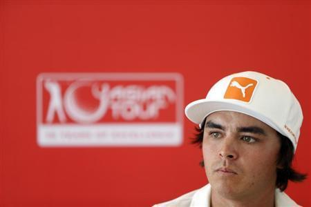 U.S. golfer Rickie Fowler addresses a news conference at the Kuala Lumpur Golf and Country Club (KLGCC) in Kuala Lumpur October 23, 2013, ahead of the CIMB Classic tournament. REUTERS/Samsul Said