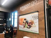 Signage is seen inside Amazon's first cash register-free grocery store, in Seattle, Washington, U.S., January 18, 2018. Photo taken January 18, 2018. REUTERS/Jeffrey Dastin