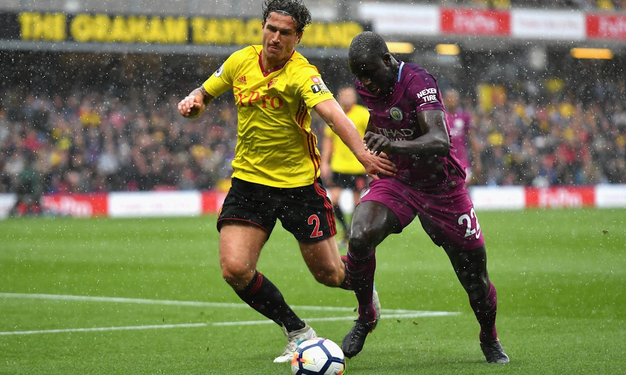 Manchester City's left-back Benjamin Mendy bursts past Daryl Janmaat of Watford during the visitors 6-0 win at Vicarage Road.