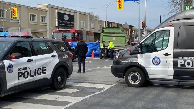 Toronto paramedics say a woman who was in a wheelchair is dead after she was struck by a truck on Danforth Avenue near Main Street on Tuesday afternoon. (Grant Linton/CBC - image credit)