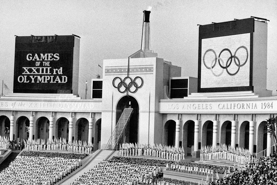 The Olympic flame is flanked by scoreboards signifying the formal opening of the the 1984 Summer Olympic Games in Los Angeles