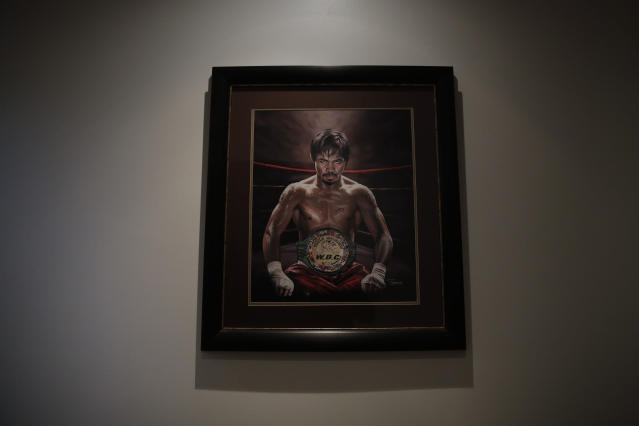 A framed portrait of boxer Manny Pacquiao hangs in the foyer of Pacquiao's home Monday, Jan. 14, 2019, in Los Angeles. The Filipino legend is in the winter of his career, gearing up for what could be one big last fight. Saturday's bout versus Broner isn't it, but Pacquiao trains with the knowledge that a second megafight against Floyd Mayweather could possibly be just months away if all goes well. (AP Photo/Jae C. Hong)