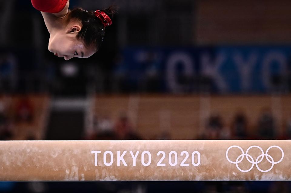<p>TOPSHOT - China's Tang Xijing competes in the artistic gymnastics women's balance beam final of the Tokyo 2020 Olympic Games at Ariake Gymnastics Centre in Tokyo on August 3, 2021. (Photo by Jeff PACHOUD / AFP) (Photo by JEFF PACHOUD/AFP via Getty Images)</p>