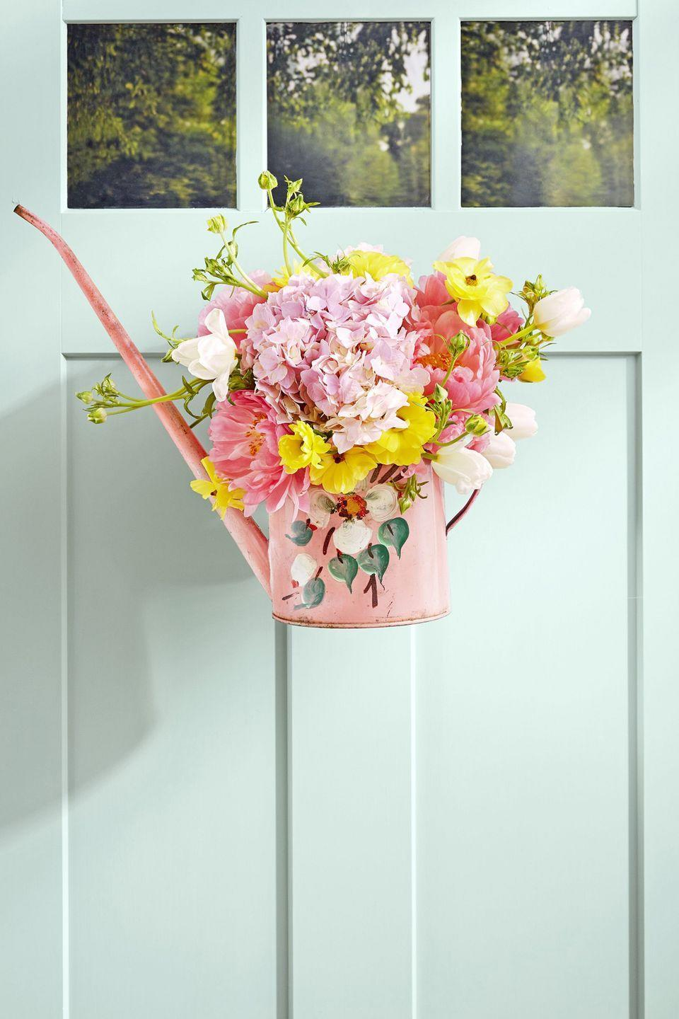 "<p>All you have to do to get this summer-ready front door look is fill the can with water and add a beautiful bouquet of flowers. Then just loop wire through the handle and hang up.</p><p><a class=""link rapid-noclick-resp"" href=""https://www.amazon.com/dp/B08DCQVLMM/ref=sbl_dpx_B08CDRFY7M_0?tag=syn-yahoo-20&ascsubtag=%5Bartid%7C10050.g.4395%5Bsrc%7Cyahoo-us"" rel=""nofollow noopener"" target=""_blank"" data-ylk=""slk:SHOP WATERING CANS"">SHOP WATERING CANS</a></p>"