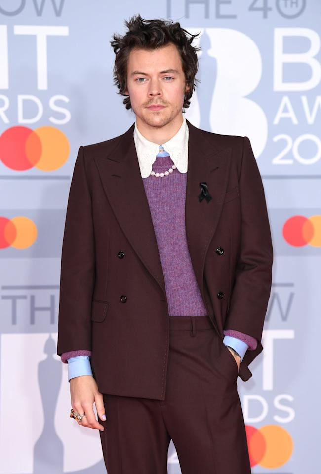 "<p>Harry Styles loves dressing up his suits with a dainty strand of pearls for a touch of whimsy. Case in point? The necklace that made this <a href=""https://www.popsugar.com/fashion/harry-styles-yellow-suit-brit-awards-2020-47230906"" class=""ga-track"" data-ga-category=""Related"" data-ga-label=""https://www.popsugar.com/fashion/harry-styles-yellow-suit-brit-awards-2020-47230906"" data-ga-action=""In-Line Links"">Gucci look at the BRIT Awards</a> complete.</p>"