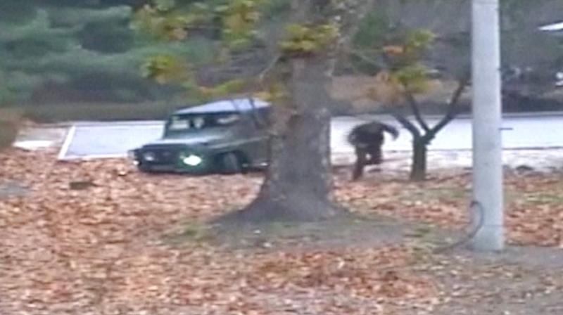United Nations Command on Tuesday released dramatic footage of a North Korean soldier defecting from his country and fleeing south across the Demilitarized Zone last week only to be fired upon by his fellow border guards.