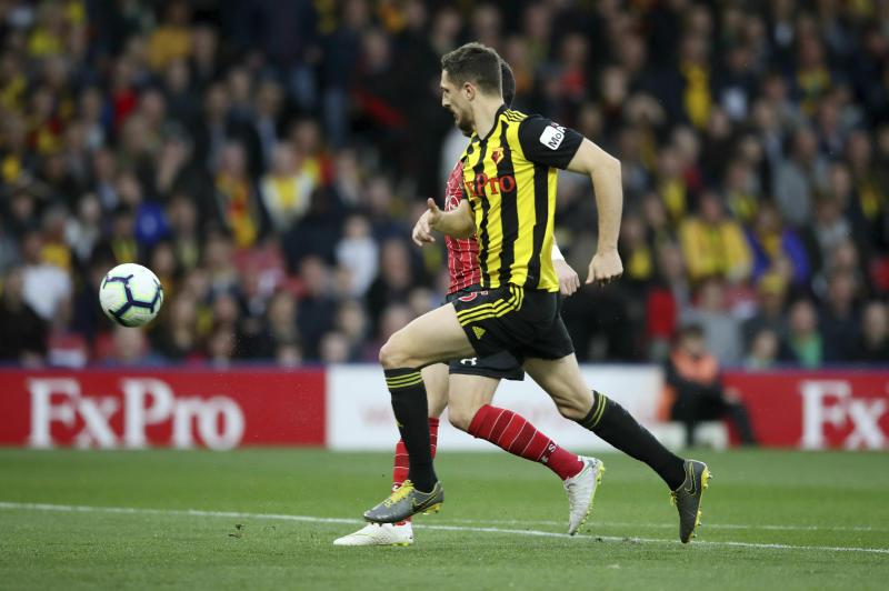 Southampton's Shane Long obscured behind scores his side's first goal of the game against Watford during their English Premier League soccer match at Vicarage Road in Watford London England Tuesday