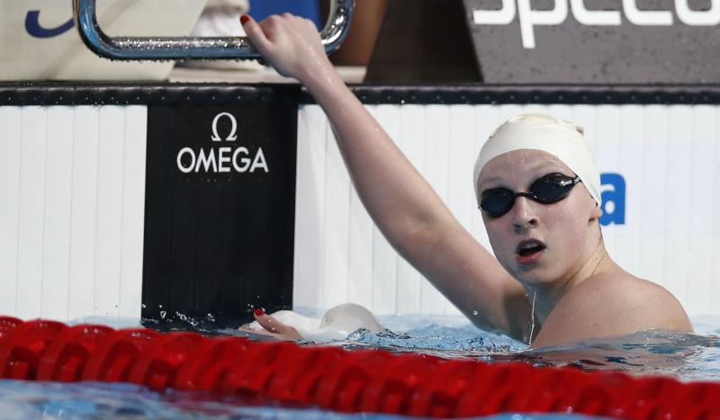 United States's Katie Ledecky looks at her time after finishing a heat of the Women's 400m freestyle at the FINA Swimming World Championships in Barcelona, Spain, Sunday, July 28, 2013. (AP Photo/Michael Sohn)