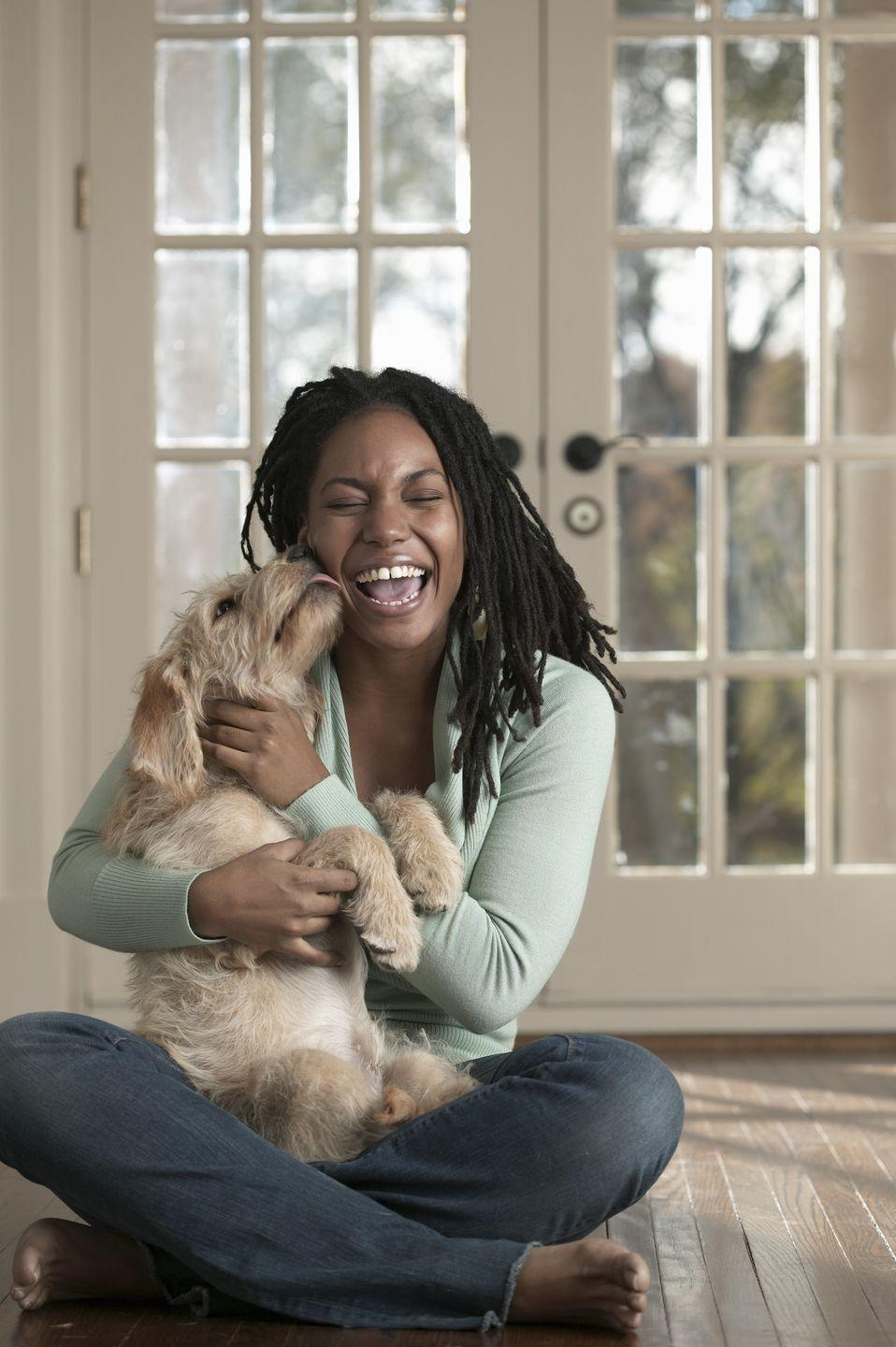 "<p>Consider this your official medical advice to spend more time on the couch with your dog. Cuddling with your pets can make you feel good, giving a boost to your mental health, which is so important when it comes to staying healthy. ""This is very calming and can reduce stress and lower your heart rate,"" says Deirdre Pierce, RN, BSN, of University of Vermont Medical Center. ""If your furry friend is the walkable type, take them for walks, which is a healthy activity for both of you."" </p>"