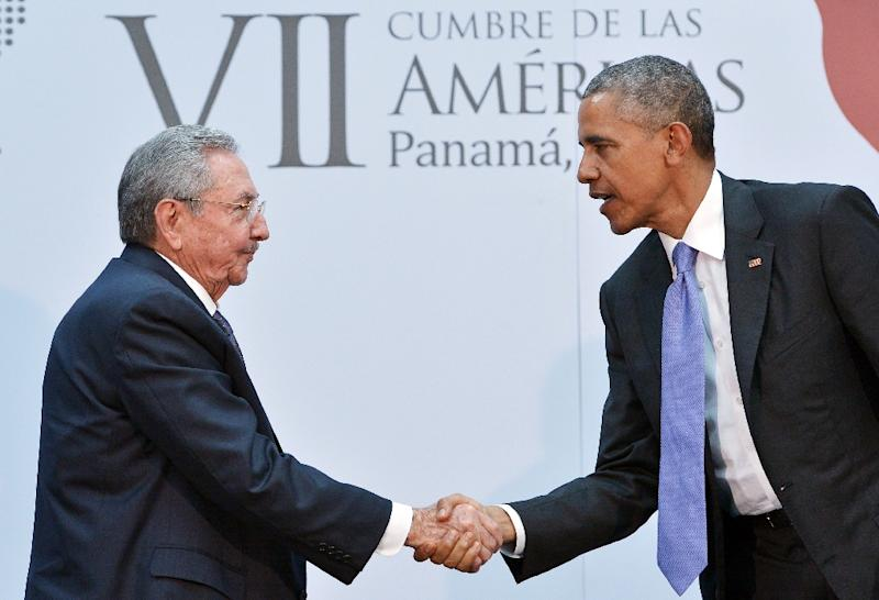 US President Barack Obama (R) shakes hands with Cuba's President Raul Castro during a meeting on the sidelines of the Summit of the Americas on April 11, 2015 in Panama City