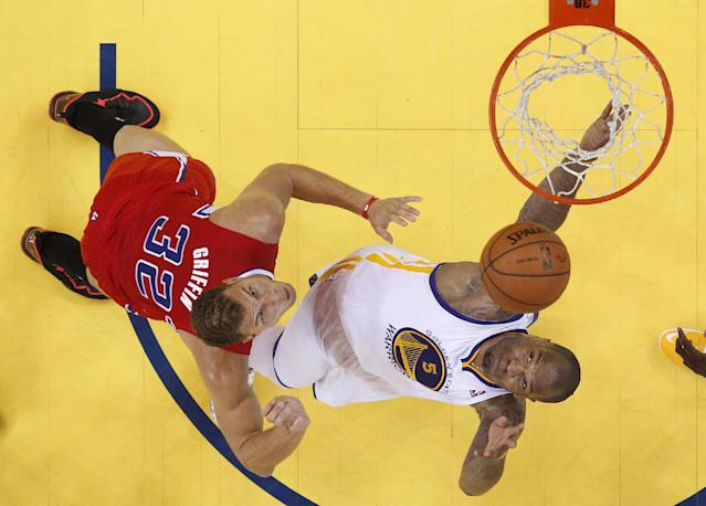 Los Angeles Clippers forward Blake Griffin (32) shoots against Golden State Warriors power forward Marreese Speights (5) during the first half of Game 6 of an opening-round NBA basketball playoff series in Oakland, Calif., Thursday, May 1, 2014. (AP Photo/Marcio Jose Sanchez)