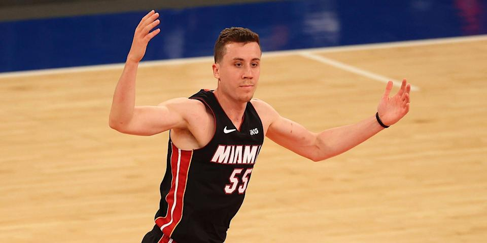 Duncan Robinson holds up his hands.