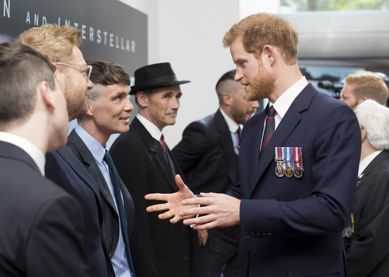 <p>Prince Harry chats with Cillian Murphy as Mark Rylance looks on (WB) </p>