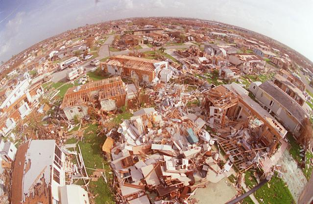 <p>This Sept. 4, 1992 aerial picture taken with a fish eye lens shows the devastation left by Hurricane Andrew in Florida City, Fla. As of Friday, Sept. 5, 2008, Ike is still far out in the Atlantic, but it's getting a close look from those who weathered 1992's Andrew, the devastating Category 5 storm against which all other Florida hurricanes are measured. (AP Photo/Mark Lennihan) </p>
