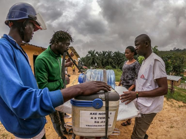 Motorcycle drivers transport the vaccines to remote areas
