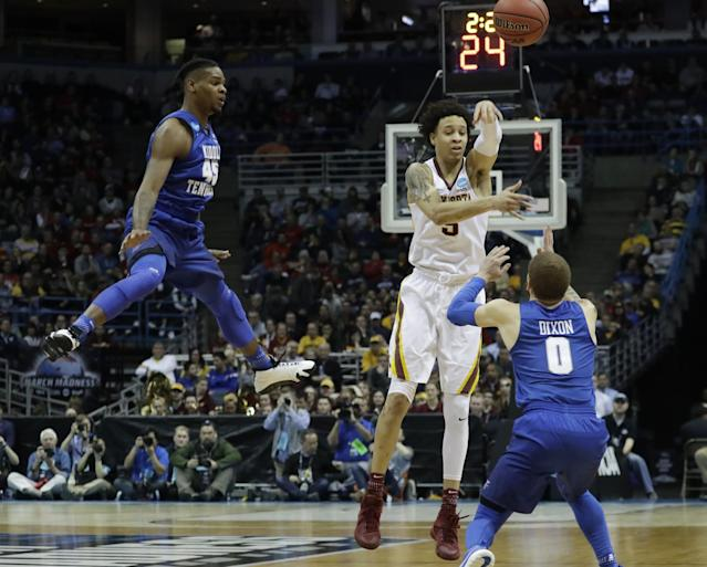 <p>Minnesota's Amir Coffey passes around Middle Tennessee State's Tyrik Dixon and Aldonis Foote (45) during the first half of an NCAA college basketball tournament first round game Thursday, March 16, 2017, in Milwaukee. (AP Photo/Morry Gash) </p>