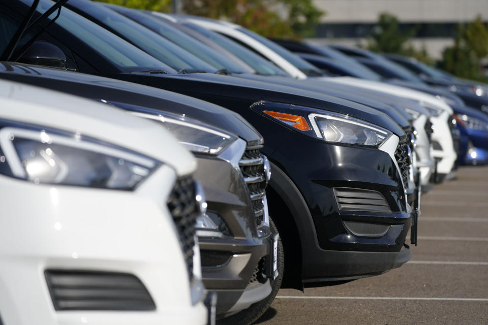 A long line of unsold 2020 Hyundai models sits in a storage lot Thursday, Sept. 3, 2020, in Centennial, Colo. (AP Photo/David Zalubowski)