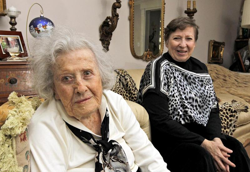 FILE - In this Nov. 8, 2010 file photo, Harriet Butler, now 102, left, and her daughter Marcia Savarese, are photographed at Savarese's home in Vienna, Va. Safety researchers expressed concern a decade ago that traffic accidents would increase as the nation's aging population swelled the number of older drivers on the road. Now, they say they've been proved wrong. Today's drivers aged 70 and older are less likely to be involved in crashes than previous generations, and less likely to be killed or seriously injured if they do crash, according to a study released Thursday by the Insurance Institute for Highway Safety. That's because vehicles are getting safer and seniors are generally getting healthier, the institute said. (AP Photo/Alex Brandon, File)