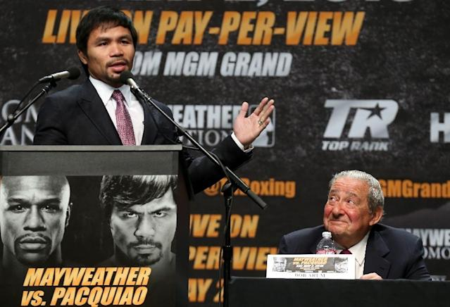 Manny Pacquiao speaks as promoter Bob Arum looks on at the Floyd Mayweather v Manny Pacquiao Press Conference on March 11, 2015 (AFP Photo/Stephen Dunn)