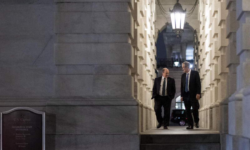 UNITED STATES - MARCH 25: Sen. Mike Crapo, R-Idaho, and Sen. Chris Coons, D-Del., leave the Capitol after voting on the Coronavirus Aid, Relief, and Economic Security Act in the Capitol on Wednesday night, March 25, 2020. (Photo By Bill Clark/CQ-Roll Call, Inc via Getty Images)