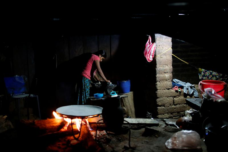 A woman makes corn tortillas at her home in Juquila Yucucani