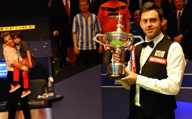 Ronnie O'Sullivan of England holds his trophy as he celebrates beating Ali Carter of England 18-11 after the World Championship Snooker final at the Crucible Theatre in Sheffield, England on May 7, 2012. AFP PHOTO/ PAUL ELLISPAUL ELLIS/AFP/GettyImages