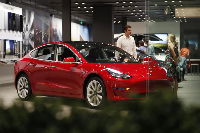 Tesla triples deliveries of electric cars but share price tumbles