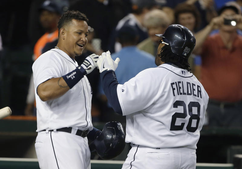 Detroit Tigers' Prince Fielder is congratulated by Miguel Cabrera, left, after hitting a two-run home run during the fifth inning of a baseball game against the Minnesota Twins in Detroit, Tuesday, April 30, 2013. (AP Photo/Carlos Osorio)