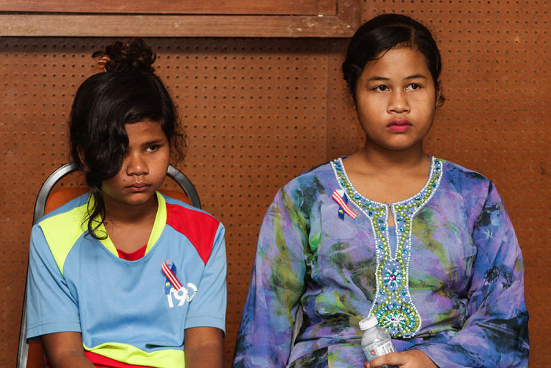Two survivors of 2015's Pos Tohoi tragedy, Miksudia Aluj, 13 (left), and Norieen Yakob, 14, attend a press conference in Kuala Lumpur August 24, 2018. — Picture by Miera Zulyana