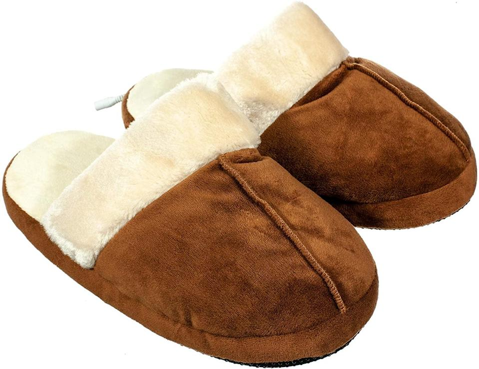 <p>Keep her feet warm and cozy with the <span>Calming Covers USB Heated Slippers</span> ($26).</p>