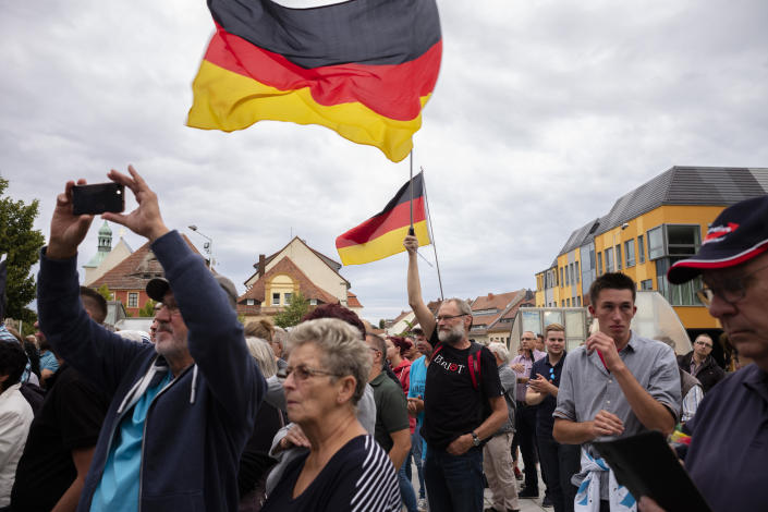 FILE - In this Thursday, Aug. 15, 2019 file photo, a crowd of people attend an election campaign rally of German Alternative for Germany, AfD, party for the Saxony state elections in Bautzen, Germany. Migration is a side issue in this year's German election campaign for the national elections on Sept. 26, but that hasn't stopped the country's biggest far-right party from trying to play it up. (AP Photo/Markus Schreiber, file)
