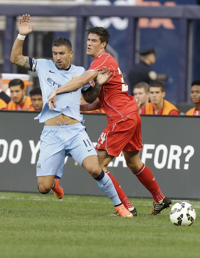 Liverpool's Martin Kelly (34) and Manchester City's Aleksandar Kolarov (11) fight for the ball in the first half of a Guinness International Champions Cup soccer tournament match Wednesday, July 30, 2014, in New York. (AP Photo/Frank Franklin II)