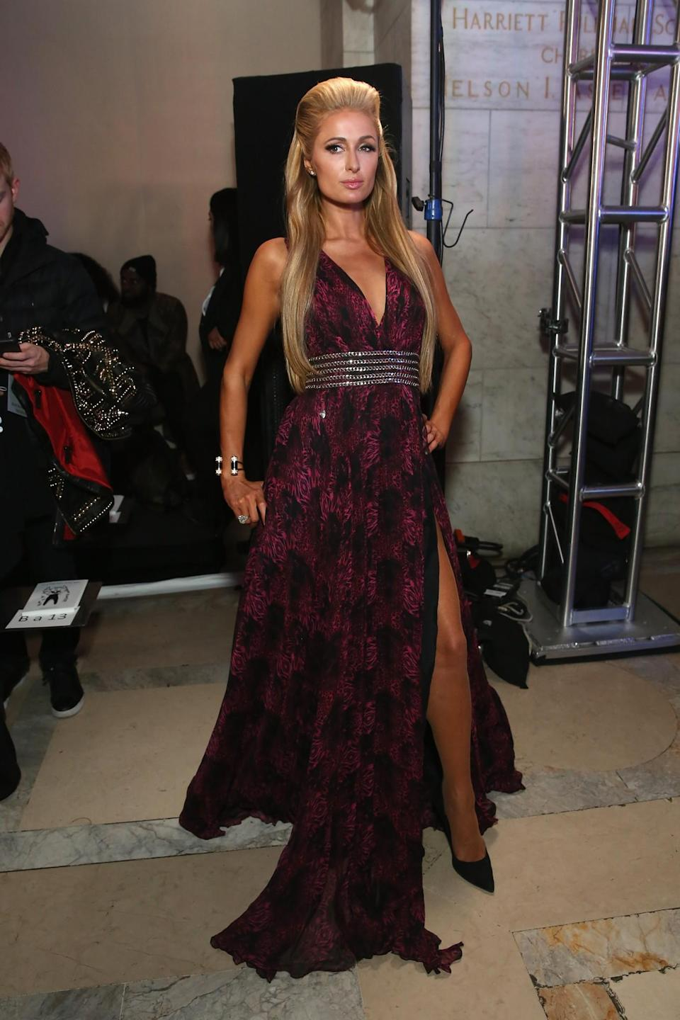 <p>Paris Hilton wore a printed gown with rhinestone detailing. <i>[Photo: Getty]</i> </p>