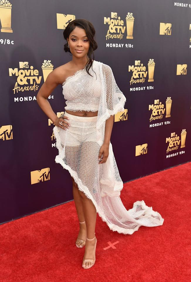 <p>...in a head-to-toe white ensemble featuring a one-shoulder crop top and asymmetrical skirt.</p>