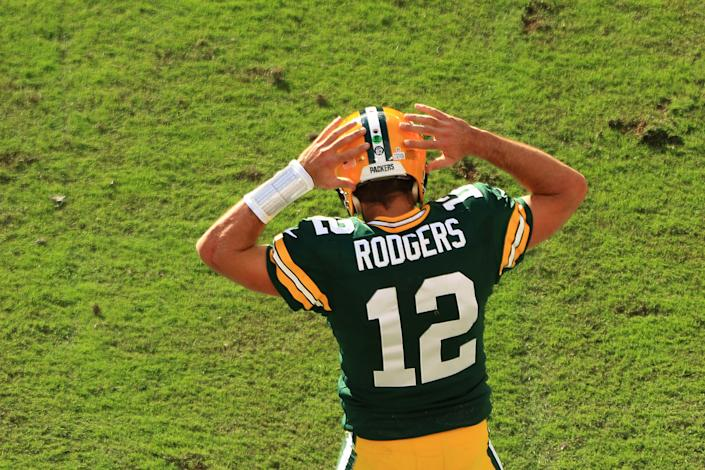 Aaron Rodgers dances in the end zone.