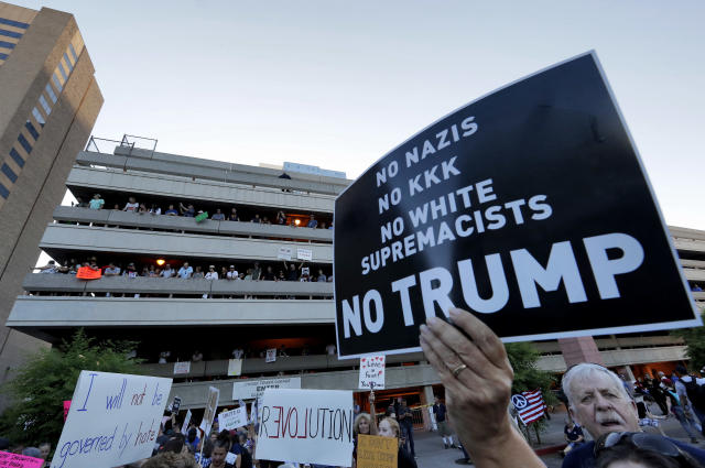 <p>People protest outside the Phoenix Convention Center, Tuesday, Aug. 22, 2017, in Phoenix. Protests were held against President Trump as he hosted a rally inside the convention center. (AP Photo/Matt York) </p>