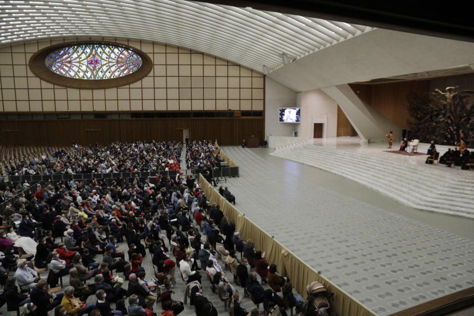Faithful gather in the Paul VI hall during Pope Francis weekly general audience at the Vatican, Wednesday, Oct. 21, 2020. The Vatican is putting an end to Pope Francis' general audiences with the public amid a surge in coronavirus cases in Italy and a confirmed infection at Oct. 21 encounter. The Vatican said Thursday that Francis would resume livestreaming his weekly catechism lessons from his library in the Apostolic Palace, as he did during the Vatican's COVID-19 lockdown over the spring and summer. (AP Photo/Gregorio Borgia)