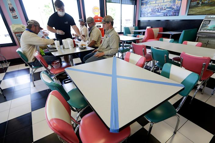 Tables are marked off for social distancing at Hwy 55 Burgers Shakes & Fries on April 27 in Nolensville, Tennessee.