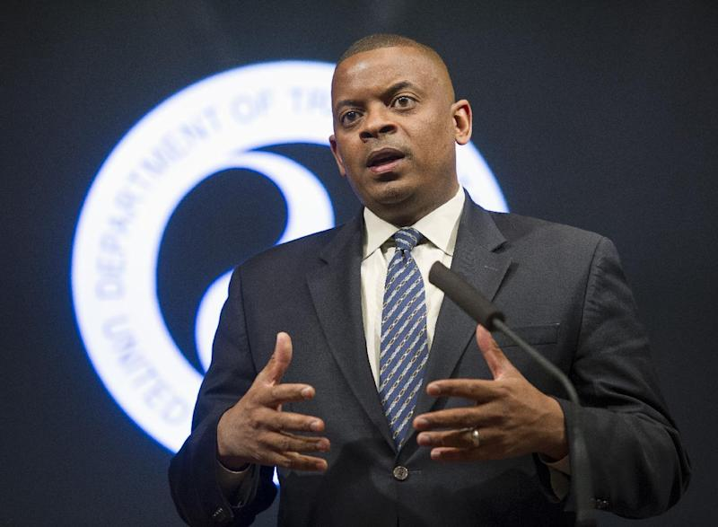 Transportation Secretary Anthony Foxx speaks during a news conference at the Transportation Department in Washington, Tuesday, Nov. 5, 2013, where it was announced that the government is issuing new airline pilot training requirements to address safety issues raised by past accidents, including a regional airline crash nearly 5 years ago that killed 50 people. (AP Photo/Cliff Owen)