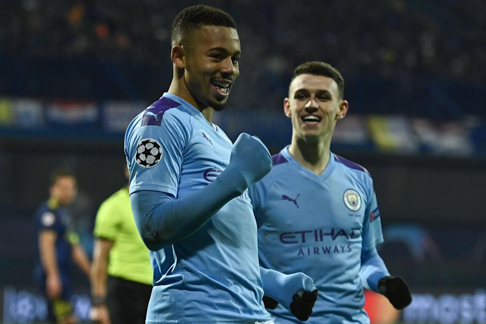 Manchester City's Brazilian striker Gabriel Jesus (L) celebrates after scoring a goal during the UEFA Champions League Group C football match between GNK Dinamo Zagreb and Manchester City FC at the Maksimir Stadium in Zagreb on December 11, 2019. (Photo by Denis LOVROVIC / AFP) (Photo by DENIS LOVROVIC/AFP via Getty Images)