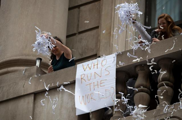 """Fans cheer as members of the World Cup-winning US women's soccer team take part in a ticker tape parade for the women's World Cup champions on July 10, 2019 in New York. - Amid chants of """"equal pay,"""" """"USA"""" and streams of confetti, the World Cup-winning US women's soccer team was feted by tens of thousands of adoring fans with a ticker-tape parade in New York on Wednesday. (Photo by Johannes Eisele/AFP/Getty Images)"""