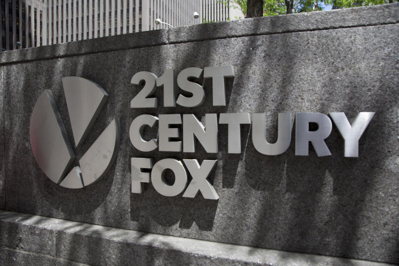 FILE - This June 14, 2018, file photo shows the 21st Century Fox logo outside its New York office. Comcast says it's dropping out of the bidding war for Twenty-First Century Fox's entertainment business, instead focusing on its bid for Sky.(AP Photo/Mark Lennihan, File)