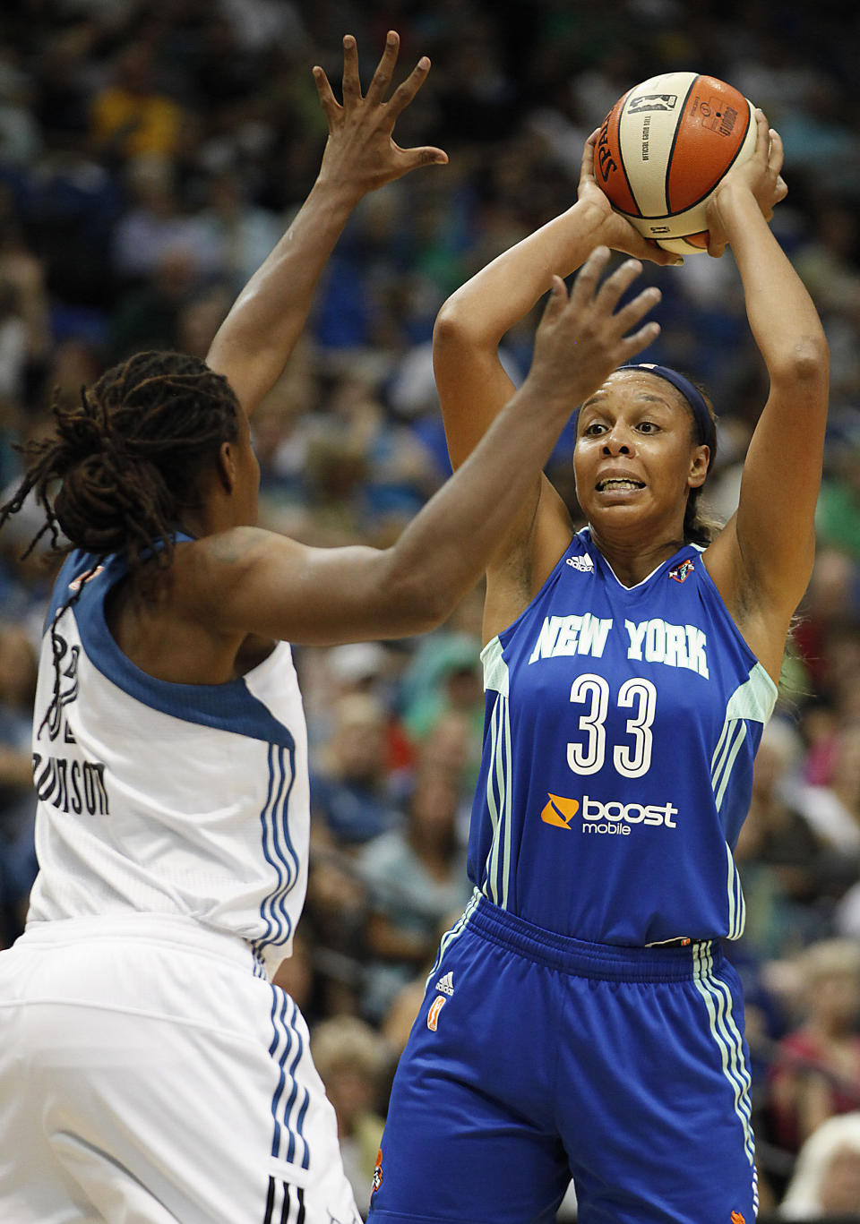New York Liberty forward Plenette Pierson (33) looks to make a pass against the defense of Minnesota Lynx forward Rebekkah Brunson (32) in the first half of a WNBA basketball game, Sunday, Aug. 18, 2013, in Minneapolis. (AP Photo/Stacy Bengs)
