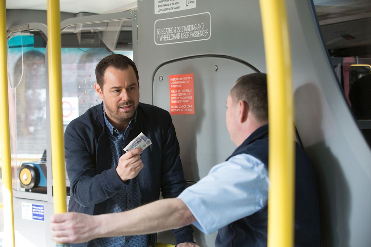 Mick Carter and Terry come to blows on a bus in 'EastEnders' (Credit: BBC)