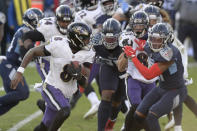 Baltimore Ravens quarterback Lamar Jackson (8) scrambles against the Tennessee Titans in the second half of an NFL wild-card playoff football game Sunday, Jan. 10, 2021, in Nashville, Tenn. The Ravens won 20-13. (AP Photo/Mark Zaleski)